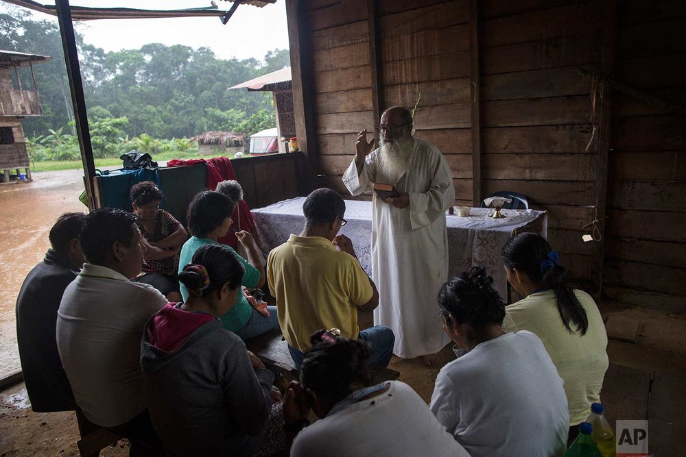 In this Jan. 15, 2018 photo, Father Pablo Zabala, better known as Padre Pablo, celebrates a private Mass for the Aguilar family in Boca Colorado, part of Peru's Madre de Dios province in the Amazon. The 70-year-old Spanish priest drove more than two miles and then walked another to reach the Aguilar family, who wished to give him a sendoff before his transfer to Puerto Maldonado. (AP Photo/Rodrigo Abd) |  See these photos on AP Images