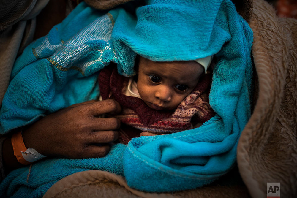In this Thursday, Jan. 18, 2018 photo a Sub-Saharan baby rests aboard the Spanish NGO Proactiva Open Arms vessel after being rescued off the Libyan coast when they were trying to reach European soil, north of Sabratha, Libya. (AP Photo/Santi Palacios)