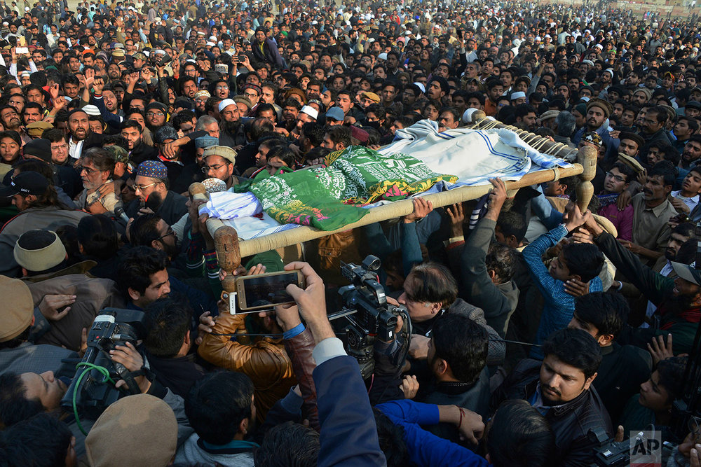 In this Wednesday, Jan. 10, 2018 photo, people attend a funeral of seven year old Zainab Ansari in Kasur, Pakistan. (AP Photo/Qazi Mehmood)  |  See these photos on AP Images