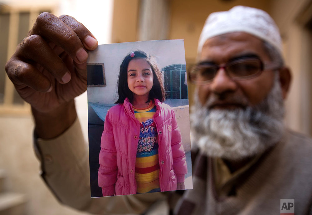 In this Thursday, Jan. 18, 2018 photo, Mohammed Amin shows a picture of his seven year-old daughter, Zainab Ansari in Kasur, Pakistan. (AP Photo/B.K. Bangash) |  See these photos on AP Images