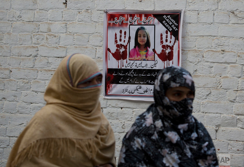 "In this Thursday, Jan. 18, 2018 photo, posters reading ""protest,"" pasted at walls of a neighborhood of  seven-year old Zainab Ansari in Kasur, Pakistan. (AP Photo/B.K. Bangash)  