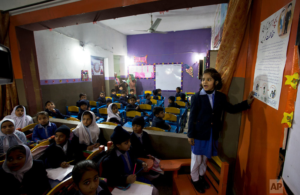 In this Friday, Jan. 19, 2018 photo. A Pakistani student shares information with her classmates regarding awareness about rape and kidnap attempt at a school in Kasur, Pakistan. (AP Photo/B.K. Bangash)  |  See these photos on AP Images