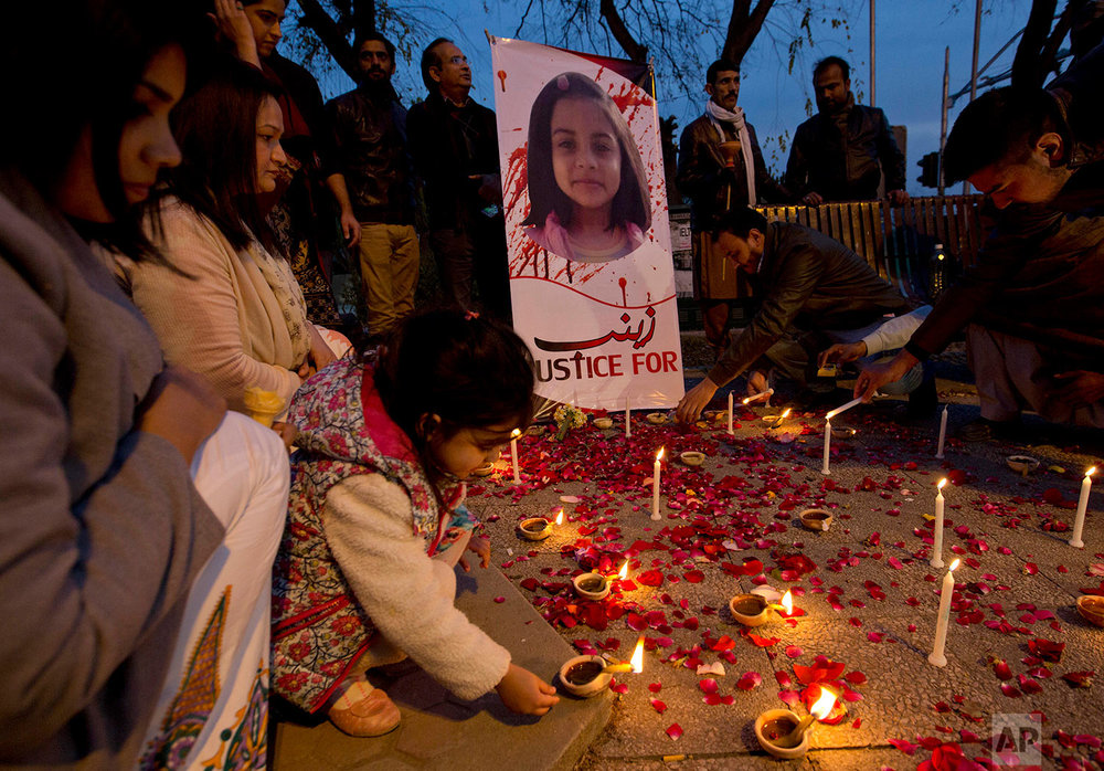 In this Thursday, Jan. 11, 2018 photo. A Pakistani girl lights a candle during a memorial for Zainab Ansari, in Islamabad, Pakistan. (AP Photo/B.K. Bangash) |  See these photos on AP Images