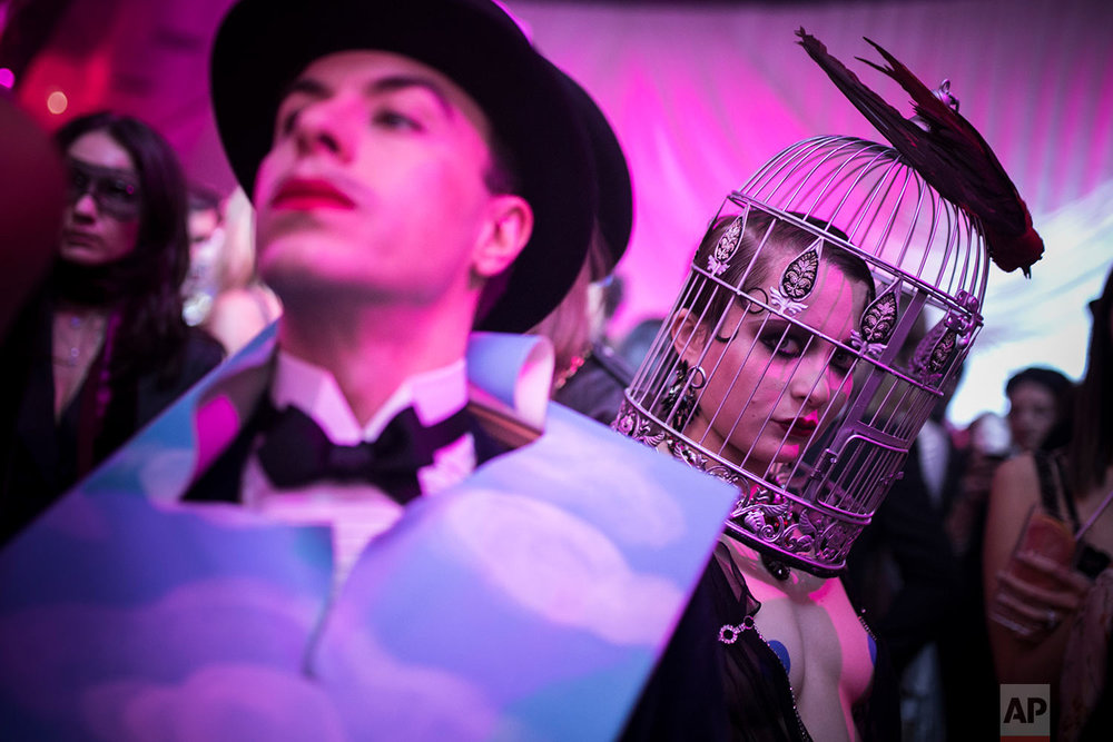 "Masked guests attend the ""Grand Bal Christian Dior"" during the Haute Couture Spring-Summer 2018 fashion collection presented in Paris, Monday, Jan. 22, 2018. (AP Photo/Kamil Zihnioglu) 