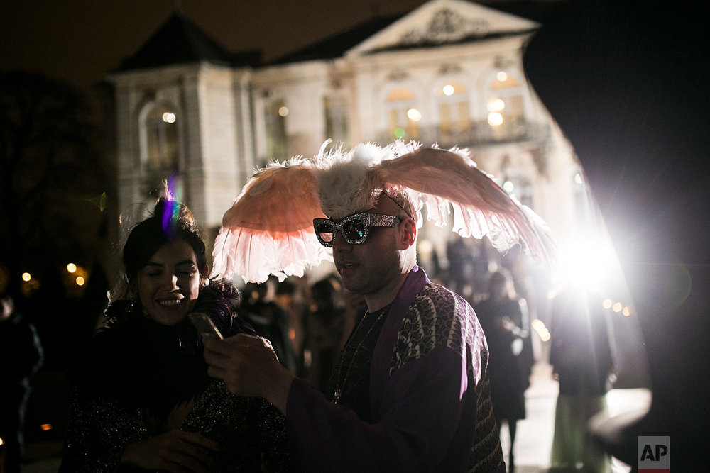 "Guests attend the ""Grand Bal Christian Dior"" during the Haute Couture Spring-Summer 2018 fashion collection presented in Paris, Monday, Jan. 22, 2018. (AP Photo/Kamil Zihnioglu) 