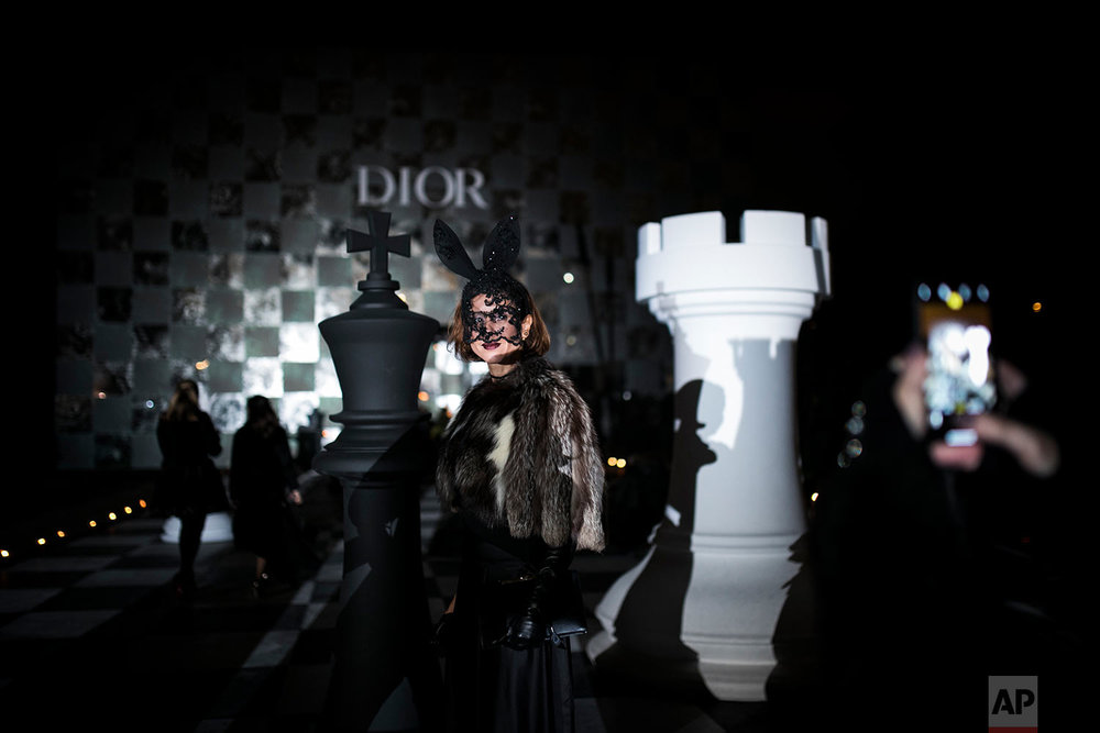 "A masked woman poses as she attends the ""Grand Bal Christian Dior"" during the Haute Couture Spring-Summer 2018 fashion collection presented in Paris, Monday, Jan. 22, 2018. (AP Photo/Kamil Zihnioglu) 
