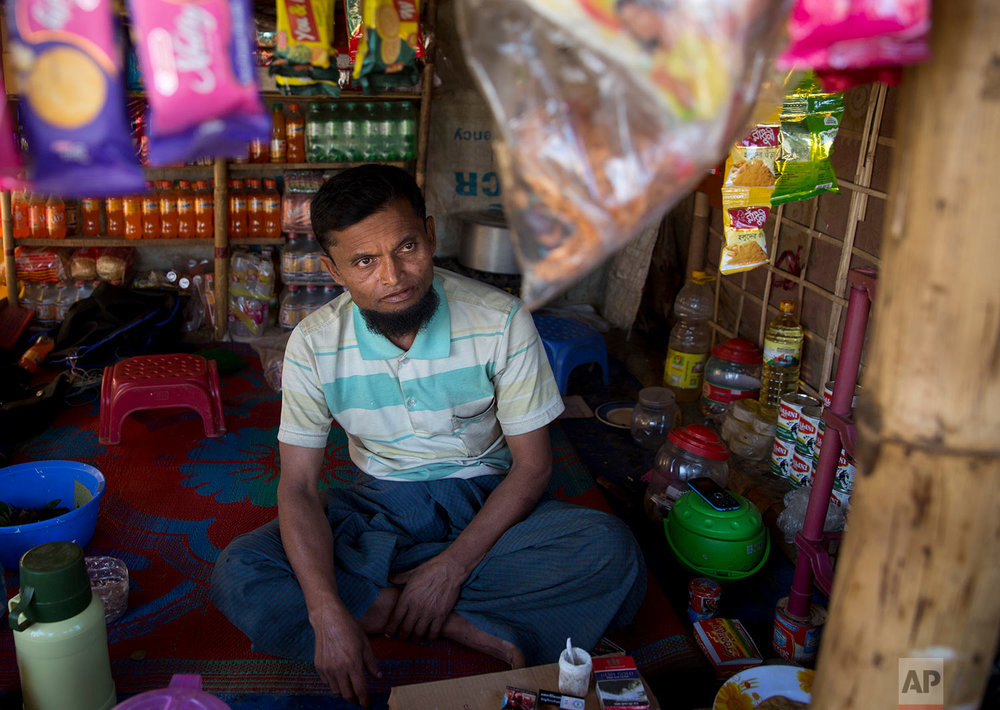 In this Tuesday, Jan. 23, 2018, photo, Abdul Gaffar, 50, who has repatriated two times, sits in his small kiosk at BaluKhali refugee camp 50 kilometers (32 miles) from, Cox's Bazar, Bangladesh, Tuesday, Jan. 23, 2018. (AP Photo/Manish Swarup)|  See these photos on AP Images