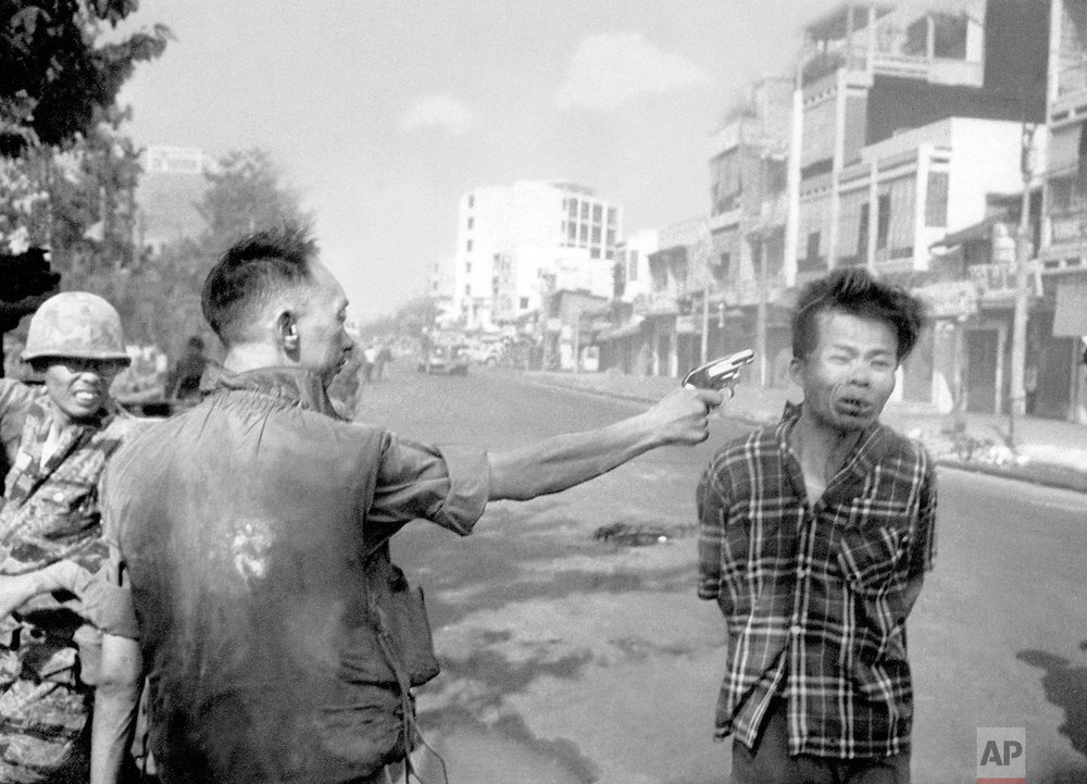 In this Feb. 1, 1968 photo, South Vietnamese Gen. Nguyen Ngoc Loan, chief of the National Police, fires his pistol into the head of suspected Viet Cong officer Nguyen Van Lem (also known as Bay Lop) on a Saigon street, early in the Tet Offensive. (AP Photo/Eddie Adams)