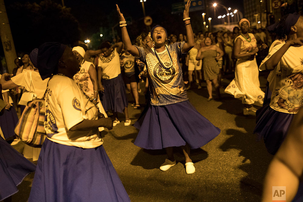 "In this Jan. 22, 2018 photo, the Paraiso do Tuiuti samba school rehearse their dances and songs that make reference to Brazil's history with slavery, in the streets of Rio de Janeiro, Brazil. Leaders of the samba group see many instances of what they consider ""modern-day slavery"" in Latin America's largest nation. (AP Photo/Leo Correa)"