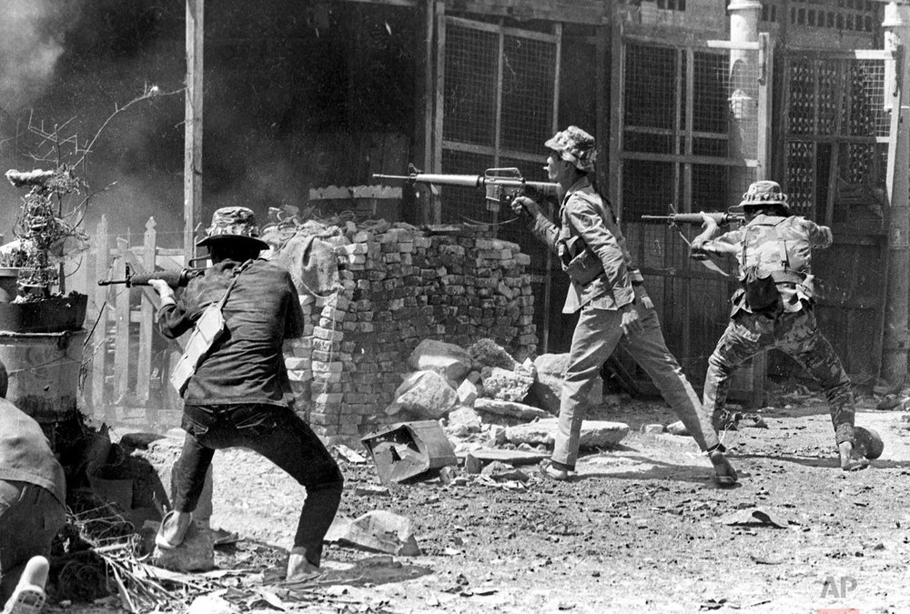South Vietnamese forces fire on enemy positions in the Saigon area in early 1968, during the Tet Offensive. (AP Photo/Nick Ut)
