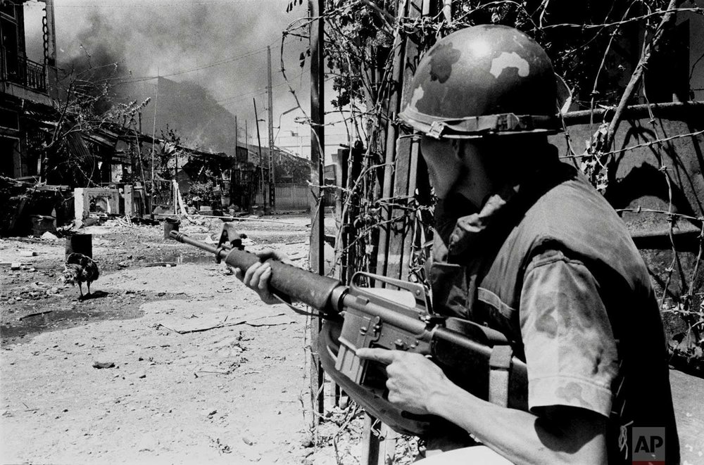 A South Vietnamese soldier takes a position on a Saigon street in early 1968, during the Tet Offensive. (AP Photo/Nick Ut)