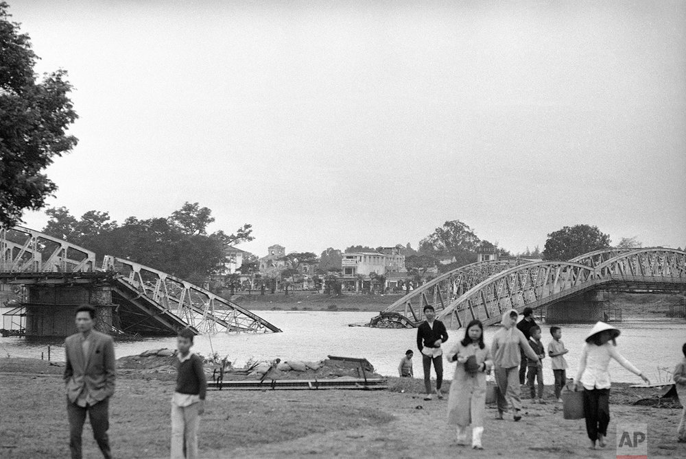 The main bridge across the Perfume River, connecting two parts of Hue, was blown up by Viet Cong, Feb. 6, 1968. The ancient Vietnamese imperial city is 50 miles south of he demilitarized zone in South Vietnam. (AP Photo/Rick Merron)