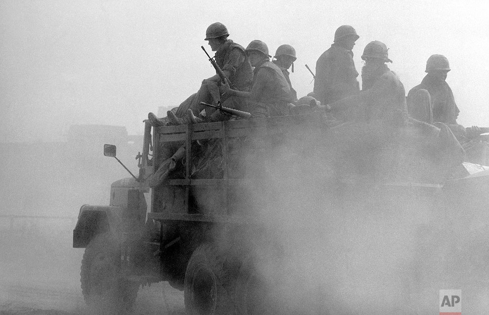 Specific date unknown. US soldiers ride in a truck at the Phu Tho racetrack in western Saigon, Feb. 8-26, 1968. US and S.Vietnamese troops set up a fire support base at the track to support troops engaged in mop-up operations throughout the city during the Tet Offensive. (AP Photo/Eddie Adams)