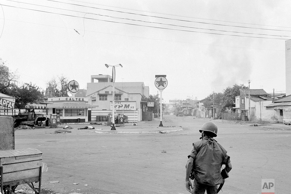 ** EDITORS NOTE: GRAPHIC CONTENT ** The bodies of some of the seven blindfolded people executed by the Viet Cong lie near gas pumps in the Cholon section of Saigon during the Tet Offensive on Feb. 9, 1968. The area had not yet been secured to recover the bodies. (AP Photo/Eddie Adams)