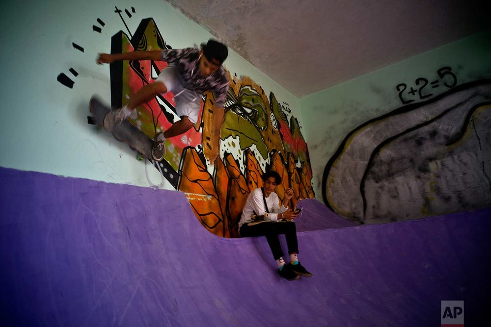 In this Jan. 11, 2018 photo, a skater practices inside an abandoned gym that was converted into a recreational space for skateboarders, the day of its inauguration inside the Educational complex Ciudad Libertad, a former military barracks that the late Fidel Castro turned into a school complex after the revolution in Havana, Cuba. (AP Photo/Ramon Espinosa)