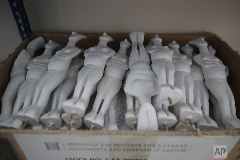 In this Monday, Jan. 22, 2018, plaster replicas of Cycladic figurines are placed on a shelf storage in Culture Ministry's Lab in Athens. (AP Photo/Thanassis Stavrakis)