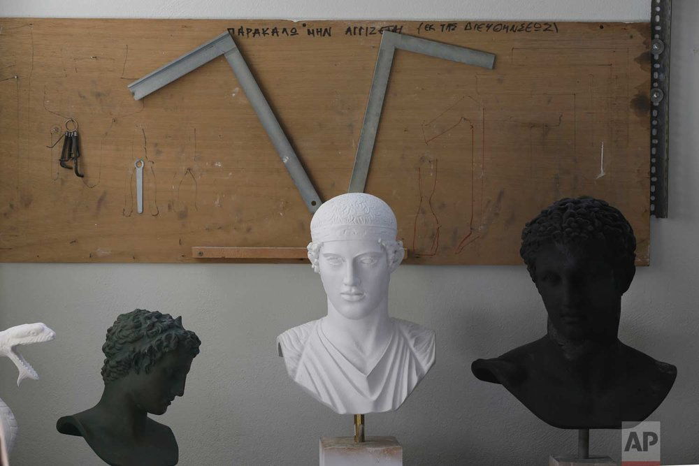 In this Monday, Jan. 22, 2018, tools are placed over ancient replicas in the Culture Ministry's Lab in Athens. (AP Photo/Thanassis Stavrakis)