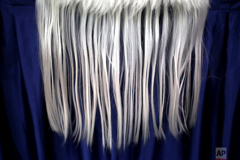 In this Friday, Feb. 2, 2018, photo, the beard of a lion costume hangs over the stage during the 11th International Lion Dance Competition in Singapore. (AP Photo/Wong Maye-E)