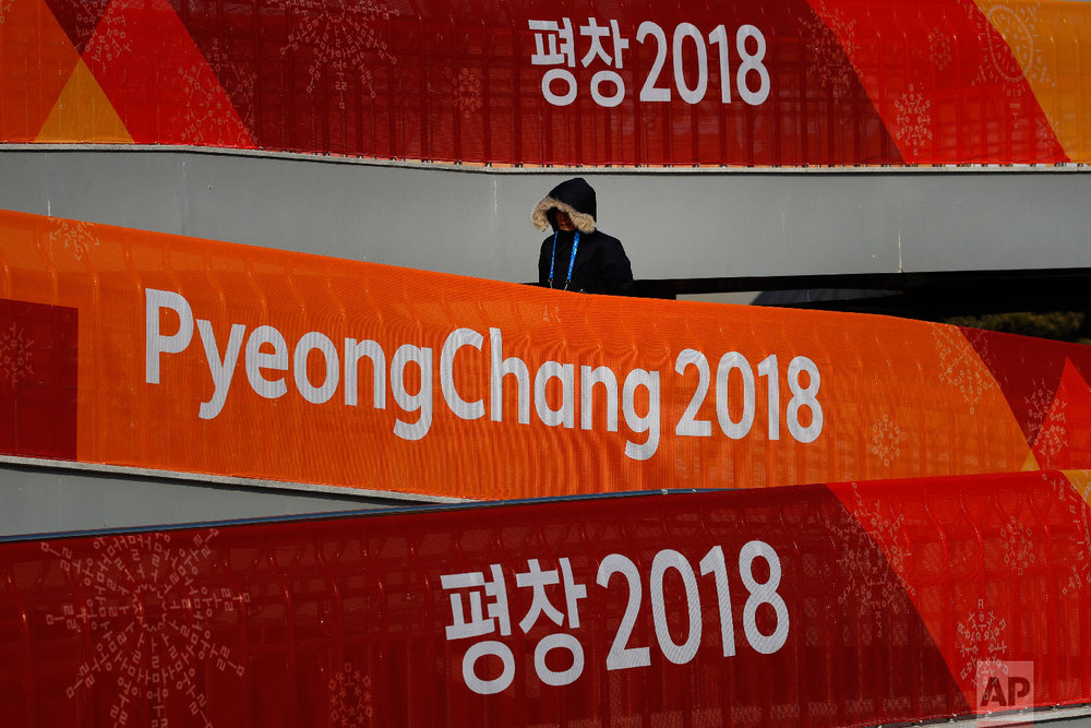 A man walks up the ramp outside the Gangneung Curling Center at the Olympic Park prior to the 2018 Winter Olympics in Gangneung, South Korea, Saturday, Feb. 3, 2018. (AP Photo/Jae C. Hong)