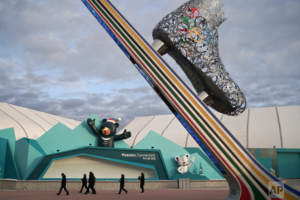 Security personnel walk at the Gangneung Olympic Park ahead of the 2018 Winter Olympics in Gangneung, South Korea, Friday, Feb. 2, 2018. The Gangneung coastal cluster is hosting the ice sports, including figure skating, speed skating, hockey and curling. (AP Photo/Felipe Dana)