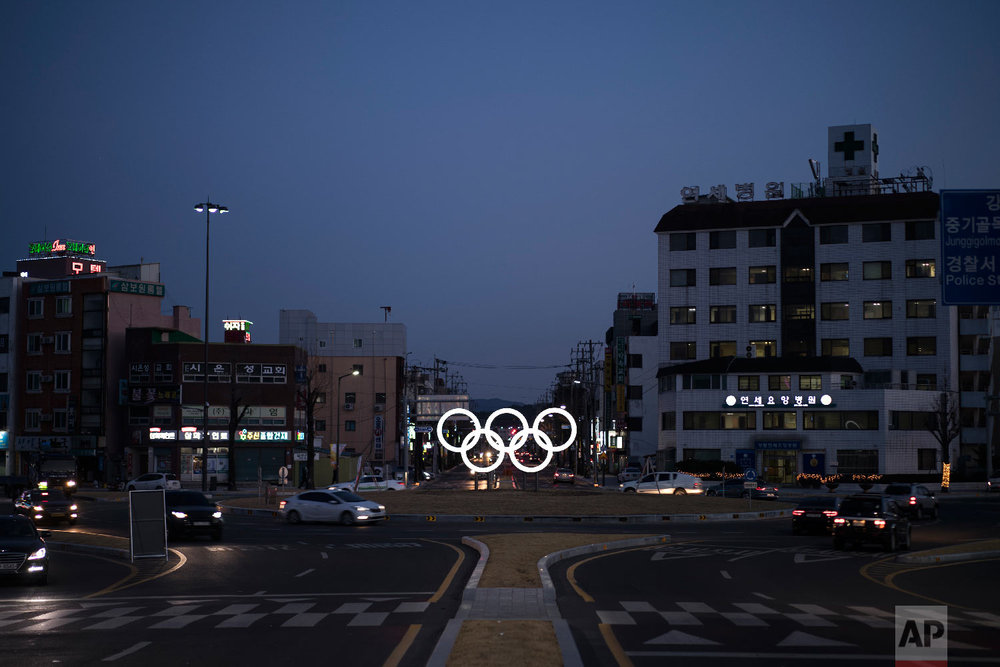 Illuminated Olympic rings shine at dusk prior to the 2018 Winter Olympics in Gangneung, South Korea, Saturday, Feb. 3, 2018. Gangneung is the site of the coastal cluster which will host ice hockey, figure skating, speed skating, short track and curling for the 2018 Olympics. (AP Photo/Felipe Dana)