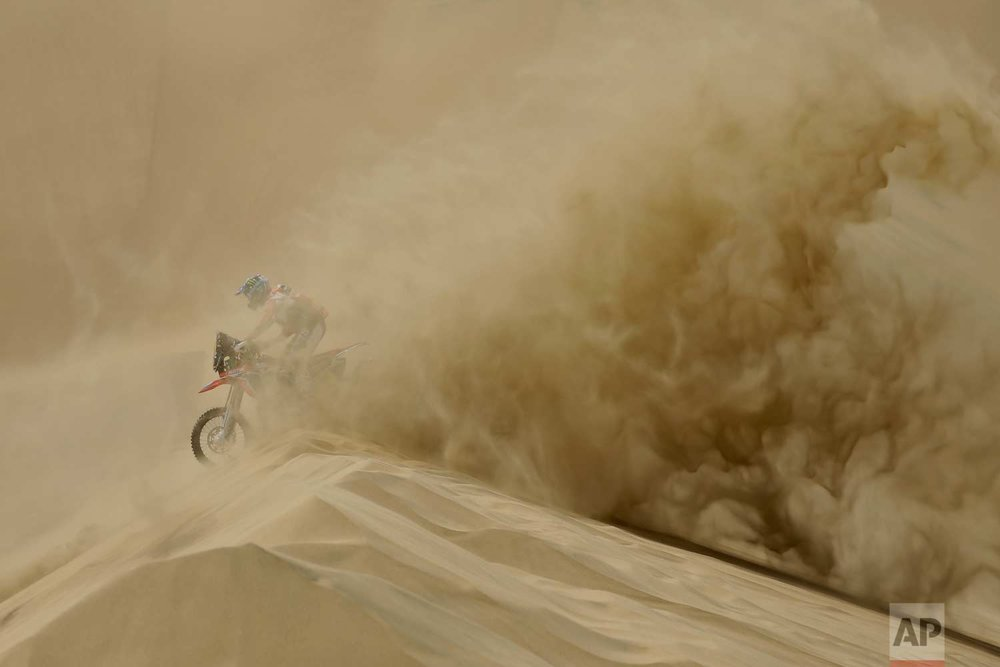 In this Saturday, Jan. 6, 2018 photo, Ricky Brabec, of the United States, rides his Honda motorbike during the first stage of the Dakar Rally between Lima and Pisco, Peru. (AP Photo/Ricardo Mazalan)
