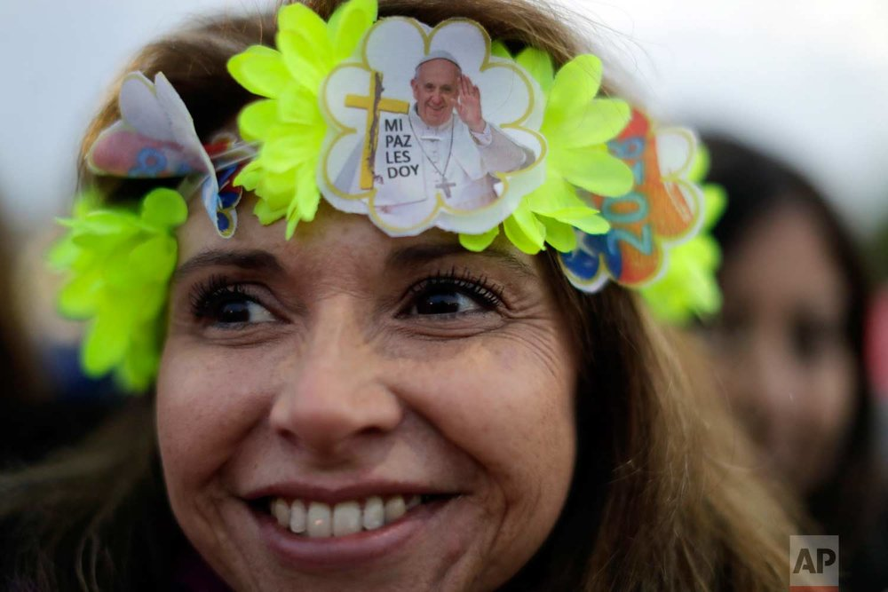 A pilgrim waits for Pope Francis to celebrate Mass at O'Higgins Park in Santiago, Chile, Tuesday, Jan. 16, 2018. (AP Photo/Natacha Pisarenko)