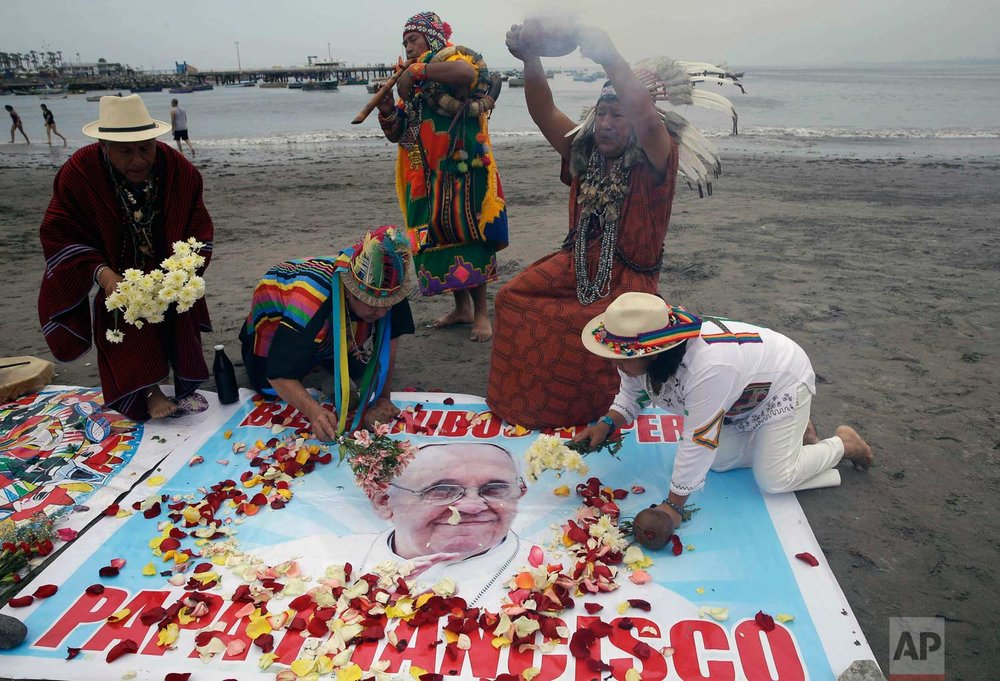 Shamans perform a welcome ritual for Pope Francis one day before he arrives to Peru, on Agua Dulce beach in Lima, Peru, Wednesday, Jan. 17, 2018. (AP Photo/Martin Mejia)
