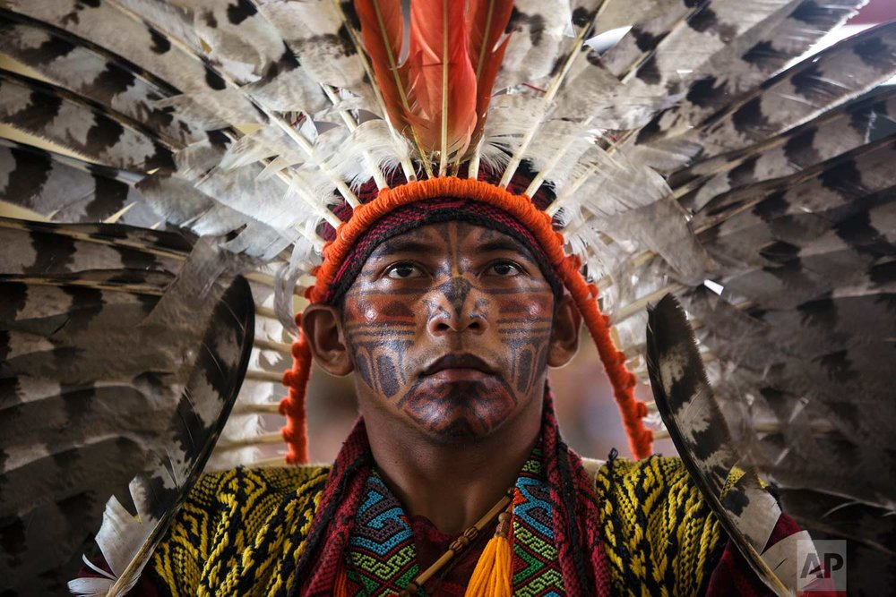 In this Thursday, Jan. 18, 2018 photo, Hunikui Antonio Borges, from Acre, Brazil, listens to a speech during a congress of Amazonian indigenous, in Puerto Maldonado, part of Peru's Madre de Dios region in the Amazon, one day ahead of Pope Francis' arrival. (AP Photo/Rodrigo Abd)