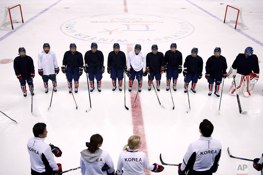 The joint Korean women's ice hockey players listen to their coaches during a training session prior to the 2018 Winter Olympics in Gangneung, South Korea, Monday, Feb. 5, 2018. (AP Photo/Jae C. Hong)