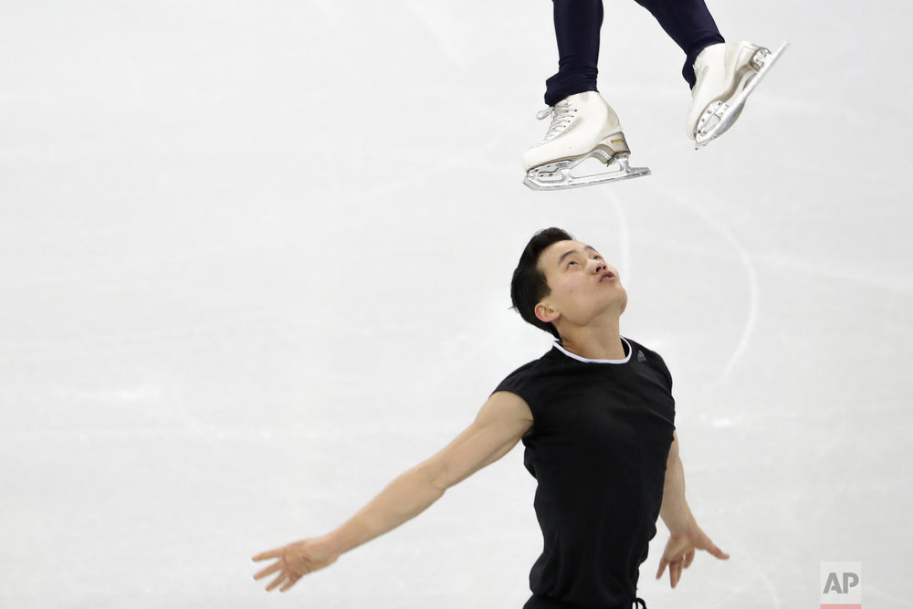 North Korea's Ryom Tae Ok and Kim Ju Sik, perform during a Pairs Figure Skating training session prior to the 2018 Winter Olympics in Gangneung, South Korea, Sunday, Feb. 4, 2018. (AP Photo/Felipe Dana)