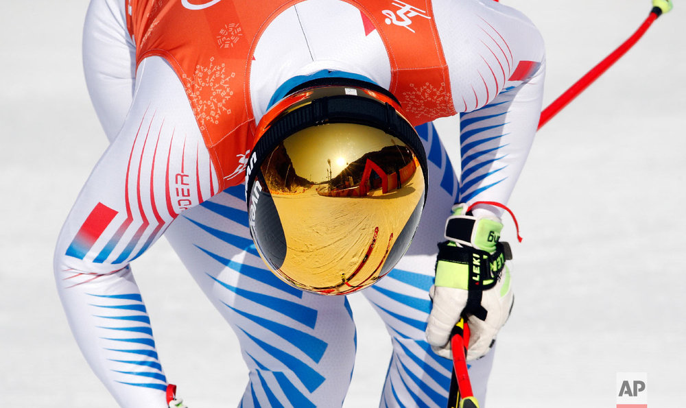 The finish area is reflected in the ski helmet of Wiley Maple of the United States after men's downhill training ahead of the 2018 Winter Olympics in Jeongseon, South Korea, Thursday, Feb. 8, 2018. (AP Photo/Christophe Ena)