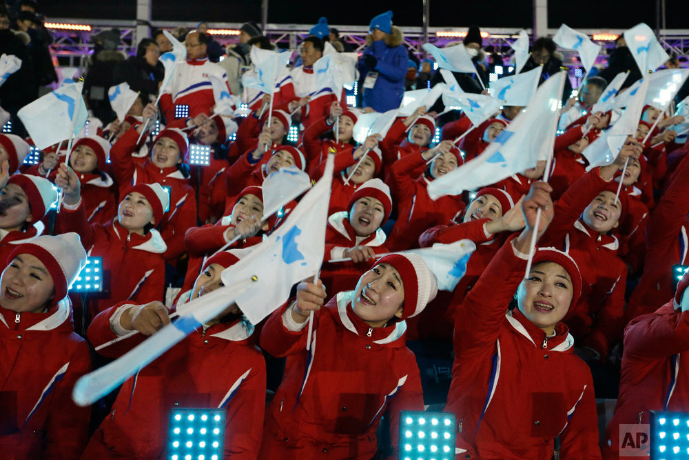 Members of the North Korean delegation wave flags of the combined Koreas before the opening ceremony of the 2018 Winter Olympics in Pyeongchang, South Korea, Friday, Feb. 9, 2018. (AP Photo/Natacha Pisarenko)