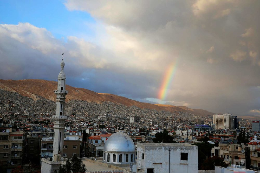 A rainbow appears over Damascus, Syria, Monday, Jan. 15, 2018. (AP Photo/Hassan Ammar)