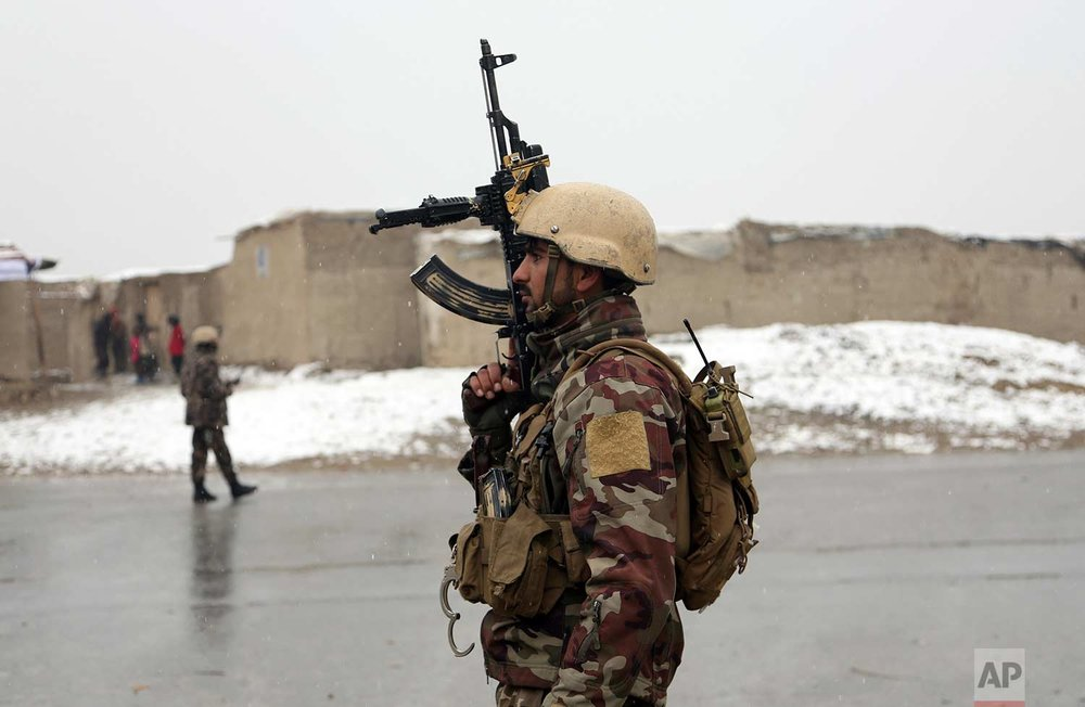 A member of Afghan security personnel stands guard at the site of an attack at the Marshal Fahim academy in Kabul, Afghanistan Monday, Jan. 29, 2018. (AP Photo/Rahmat Gul)
