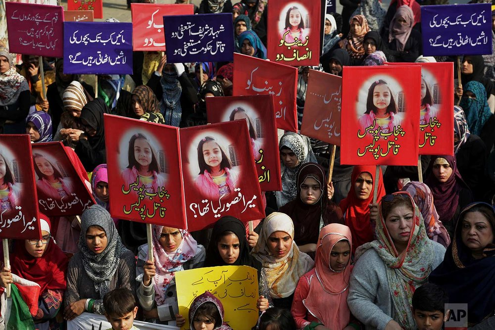 Supporters of Pakistan Awami Tehreek take part in a demonstration to condemn the brutal killing of Zainab Ansari, an 8-year-old girl, in Lahore, Pakistan, Saturday, Jan. 13, 2018. A Pakistani official says a serial killer may have been behind the rape and murder of the young girl which has sparked deadly clashes between protesters and police. (AP Photo/K.M. Chaudary)