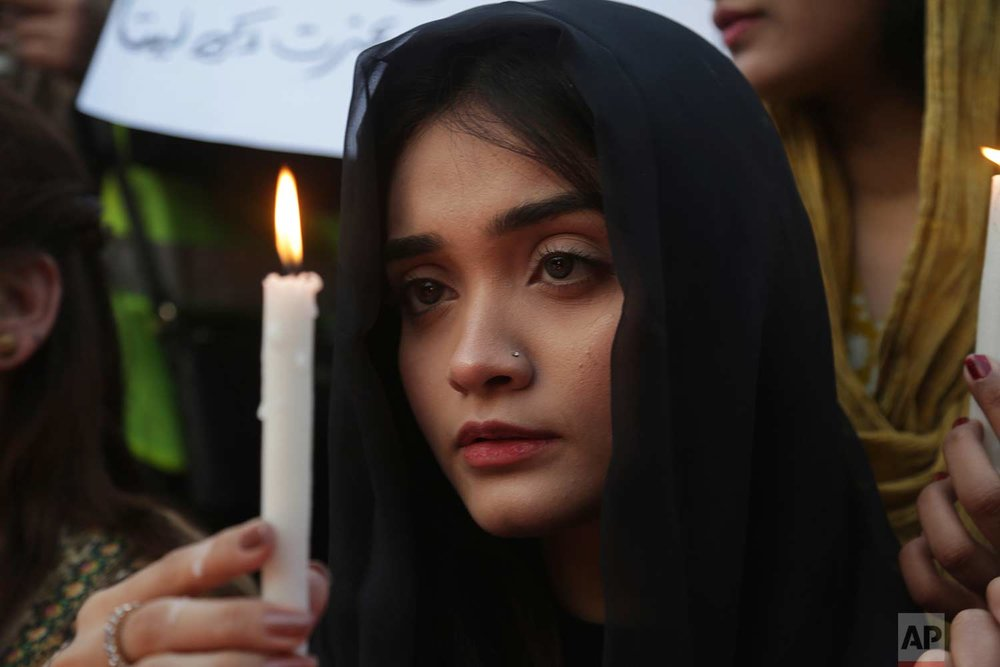 A Pakistani girl joins others during a memorial for Zainab Ansari, an 8-year-old girl who was kidnapped, raped and killed, in Lahore, Pakistan, Friday, Jan. 12, 2018. (AP Photo/K.M. Chaudary)