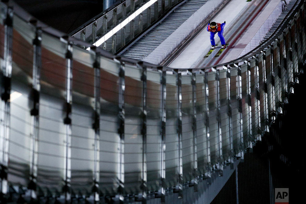 Richard Freitag, of Germany, competes during the men's normal hill individual ski jumping competition at the 2018 Winter Olympics in Pyeongchang, South Korea, Saturday, Feb. 10, 2018. (AP Photo/Matthias Schrader)