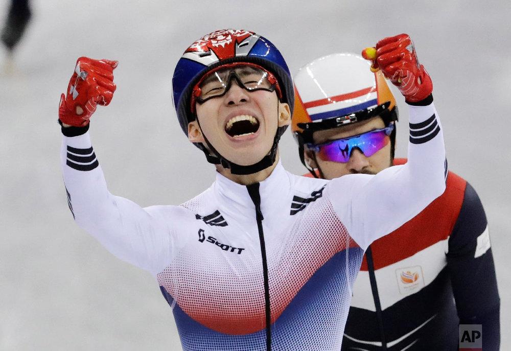 Lim Hyojun, of South Korea, celebrates after winning the men's 1500 meters short-track speedskating final in the Gangneung Ice Arena at the 2018 Winter Olympics in Gangneung, South Korea, Saturday, Feb. 10, 2018. (AP Photo/Bernat Armangue)