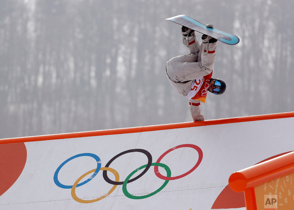 RyanStassel, of the United States, jumps during the men's slopestyle qualifying at Phoenix Snow Park at the 2018 Winter Olympics in Pyeongchang, South Korea, Saturday, Feb. 10, 2018. (AP Photo/Gregory Bull)