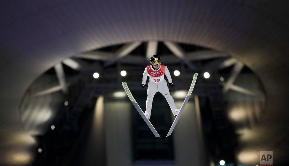 Daiki Ito, of Japan, soars through the air during the men's normal hill individual ski jumping competition at the 2018 Winter Olympics in Pyeongchang, South Korea, Saturday, Feb. 10, 2018. (AP Photo/Kirsty Wigglesworth)