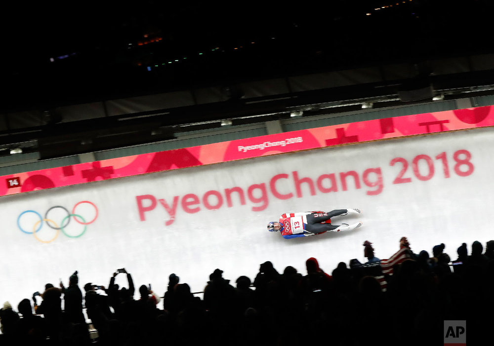 Chris Mazdzer of United States competes in the first round of the men's luge at the 2018 Winter Olympics in Pyeongchang, South Korea, Saturday, Feb. 10, 2018. (AP Photo/Andy Wong)