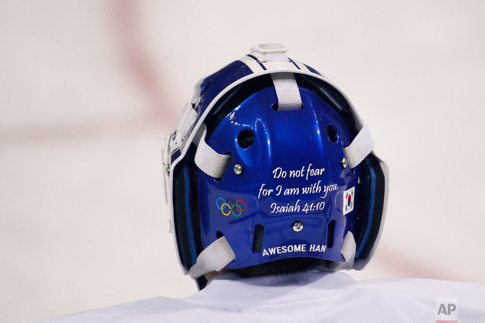 A Bible verse is written on the back of the joint Korean women's ice hockey team goalie Han Dohee's mask during a training session prior to the 2018 Winter Olympics in Gangneung, South Korea, Monday, Feb. 5, 2018. (AP Photo/Jae C. Hong)