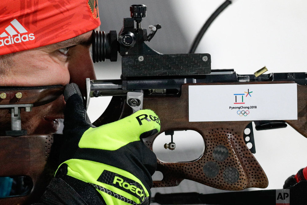 Arnd Pfeiffer, of Germany, shoots from the prone position during the men's 12.5-kilometer biathlon pursuit at the 2018 Winter Olympics in Pyeongchang, South Korea, Monday, Feb. 12, 2018. (AP Photo/Andrew Medichini)