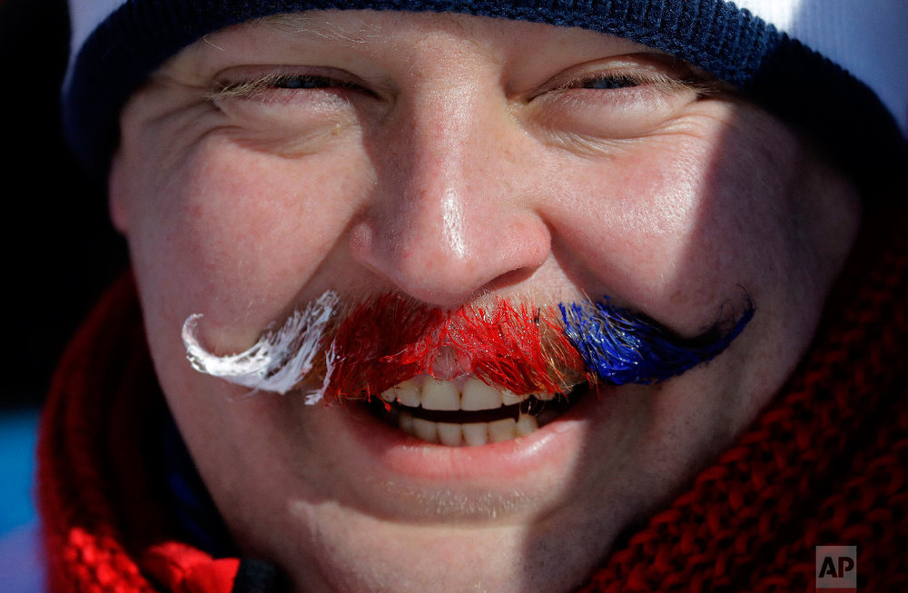 A fan of Sarka Pancochova, of the Czech Republic, waits for competition to begin prior to the women's slopestyle final at Phoenix Snow Park at the 2018 Winter Olympics in Pyeongchang, South Korea, Monday, Feb. 12, 2018. (AP Photo/Lee Jin-man)