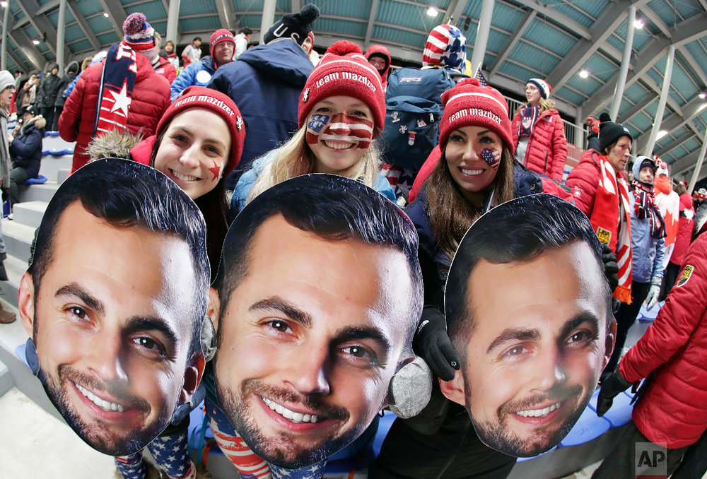 Supporters of luger Chris Mazdzer, of the United States, wait for the first run to start at the 2018 Winter Olympics in Pyeongchang, South Korea, Saturday, Feb. 10, 2018. (AP Photo/Michael Sohn)