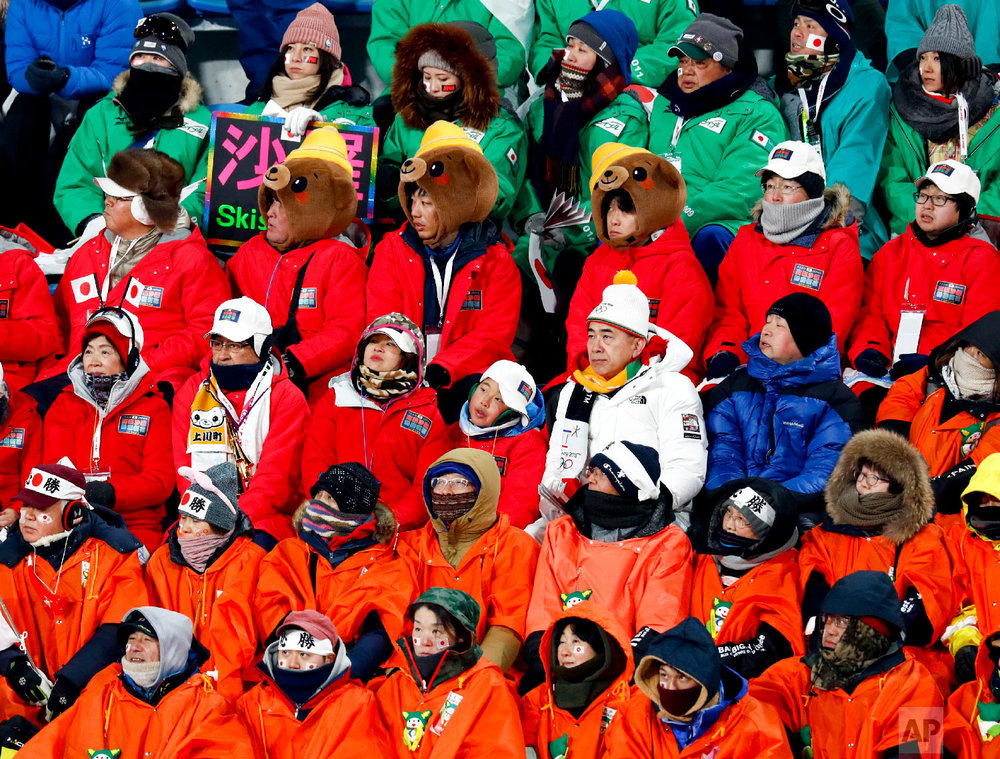 Fans watch during the women's normal hill individual ski jumping competition at the 2018 Winter Olympics in Pyeongchang, South Korea, Monday, Feb. 12, 2018. (AP Photo/Matthias Schrader)