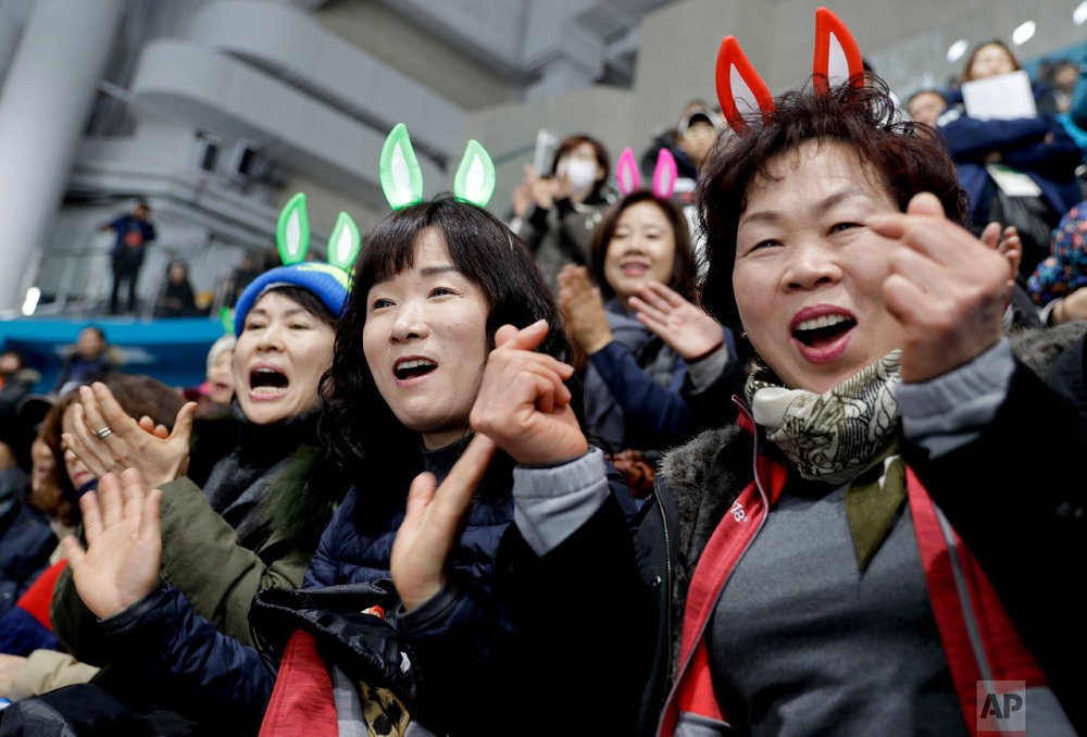 South Korea's fans cheer their team during a mixed doubles curling match against Olympic Athletes from Russia at the 2018 Winter Olympics in Gangneung, South Korea, Saturday, Feb. 10, 2018. (AP Photo/Natacha Pisarenko)