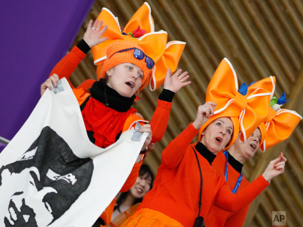 Fans clad in the colors of the Netherlands team hold a flag with the face of speed skater Sven Kramer of The Netherlands prior to the men's 5,000 meters race at the Gangneung Oval at the 2018 Winter Olympics in Gangneung, South Korea, Sunday, Feb. 11, 2018. (AP Photo/Vadim Ghirda)