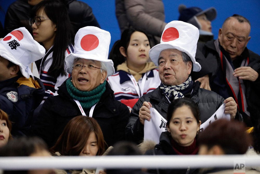 Japanese fans wait before the preliminary round of the women's hockey game between Switzerland and Japan at the 2018 Winter Olympics in Gangneung, South Korea, Monday, Feb. 12, 2018. (AP Photo/Julio Cortez)
